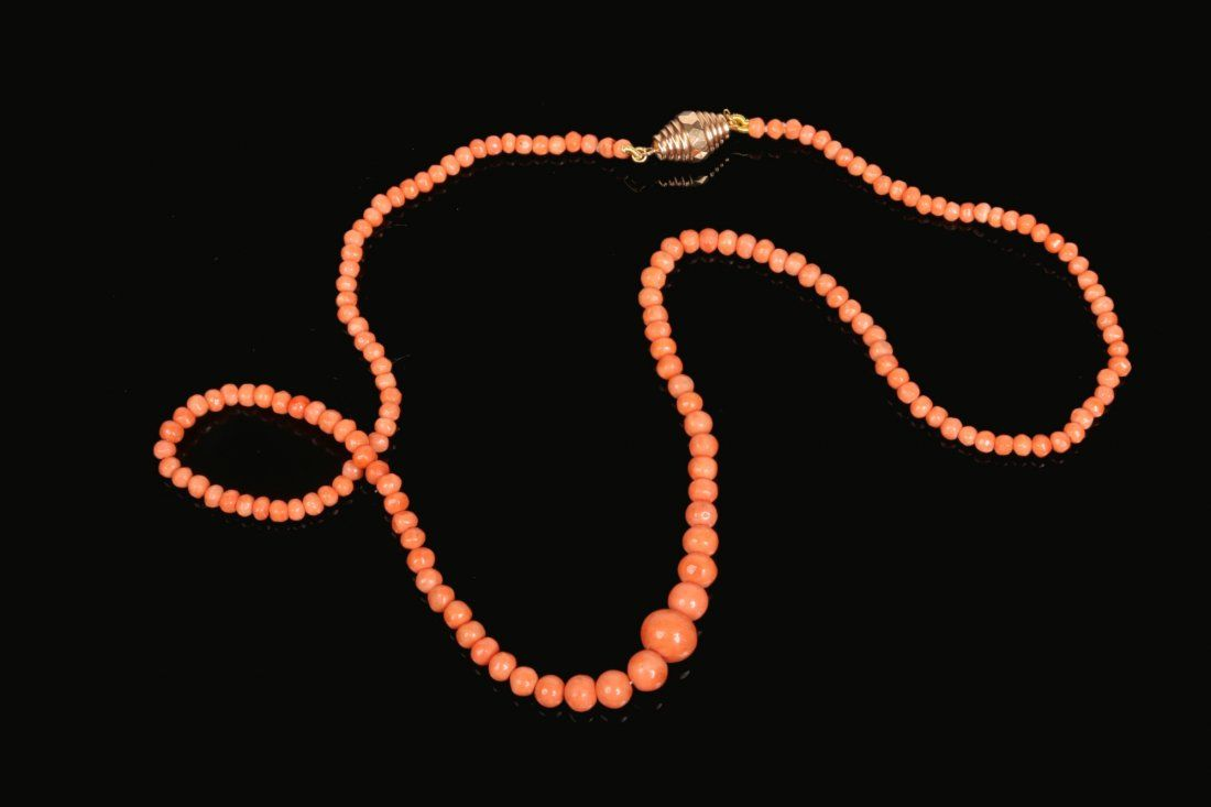 A French graduated coral bead necklace with 18 carat