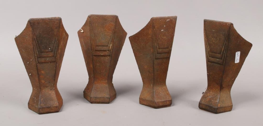 Four Art Deco cast iron feet stamped Magna, removed