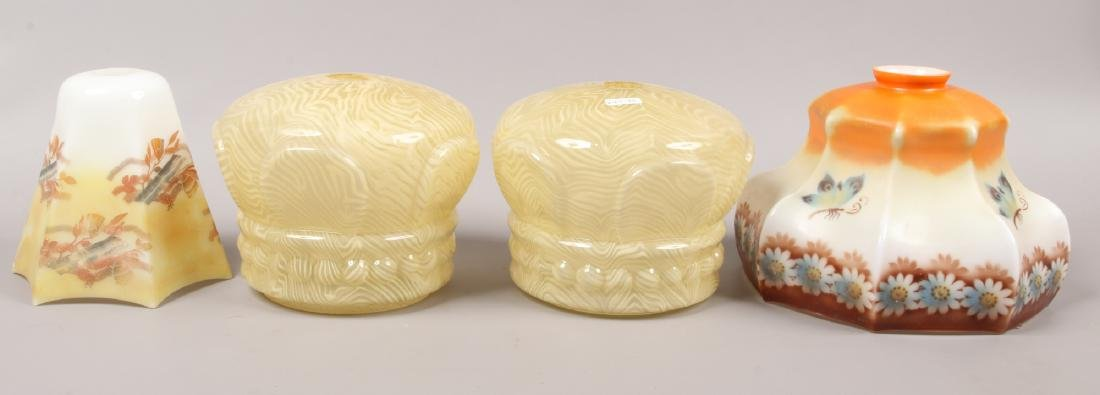 A pair of 1950s glass lamp shades formed as crowns