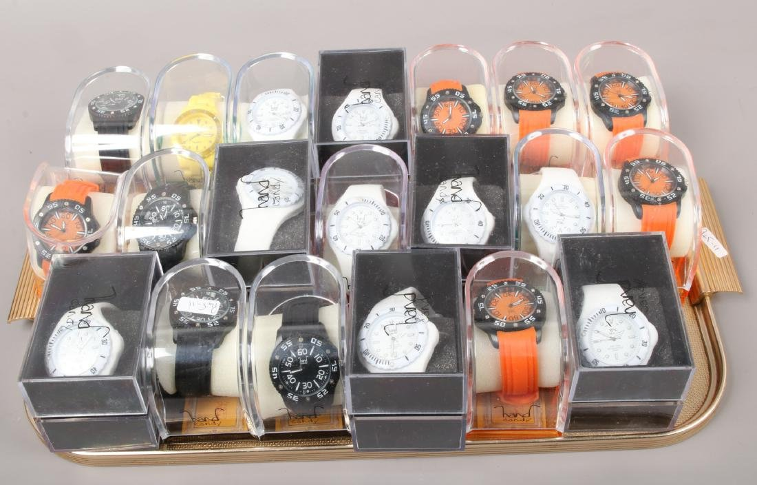 A tray of 20 cased hand candy quartz wristwatches.