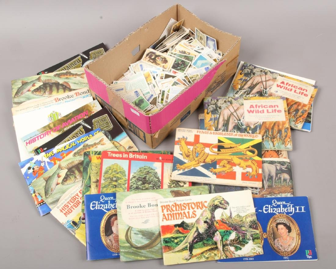 A box of tea cards loose and in albums.
