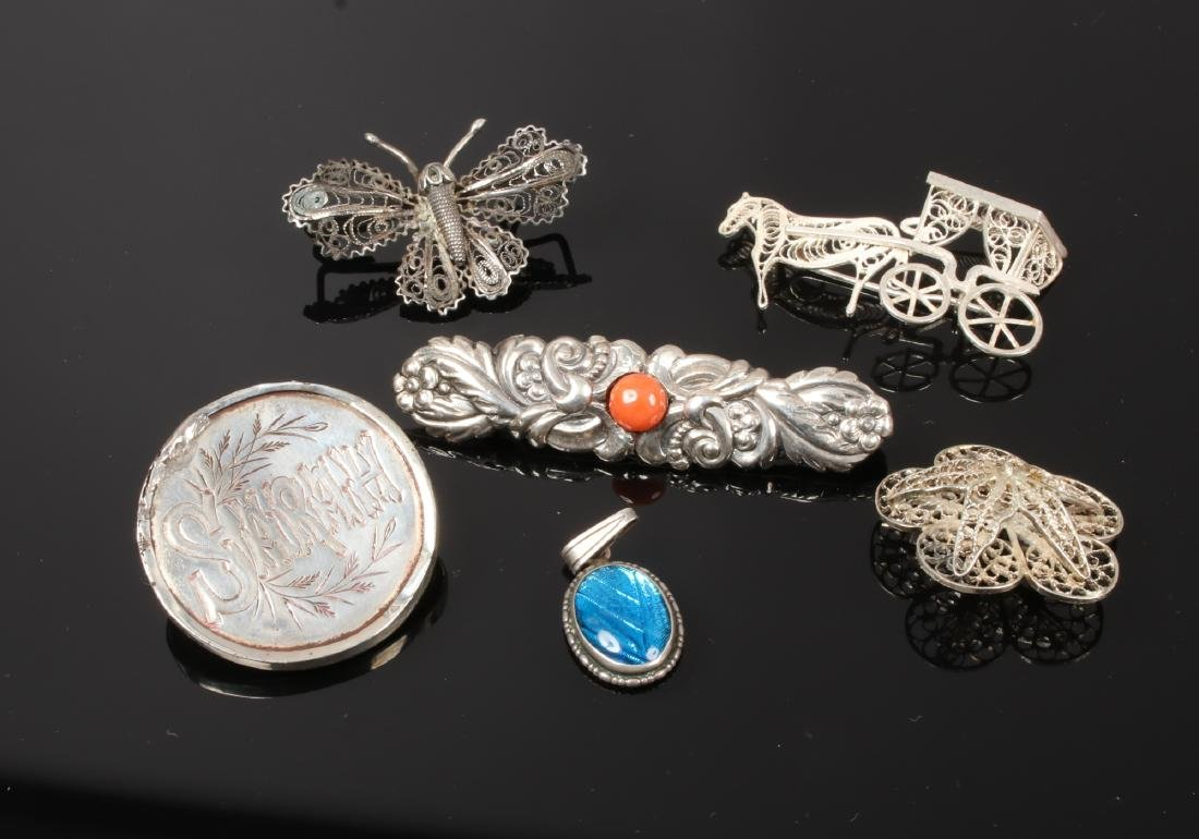Five silver brooches including filigree examples and a