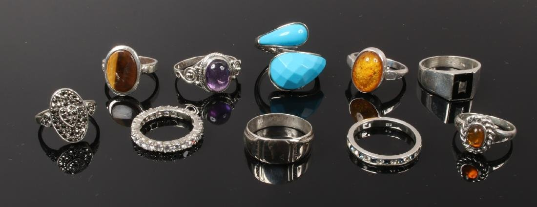 Ten silver dress rings including marcasite, amber and