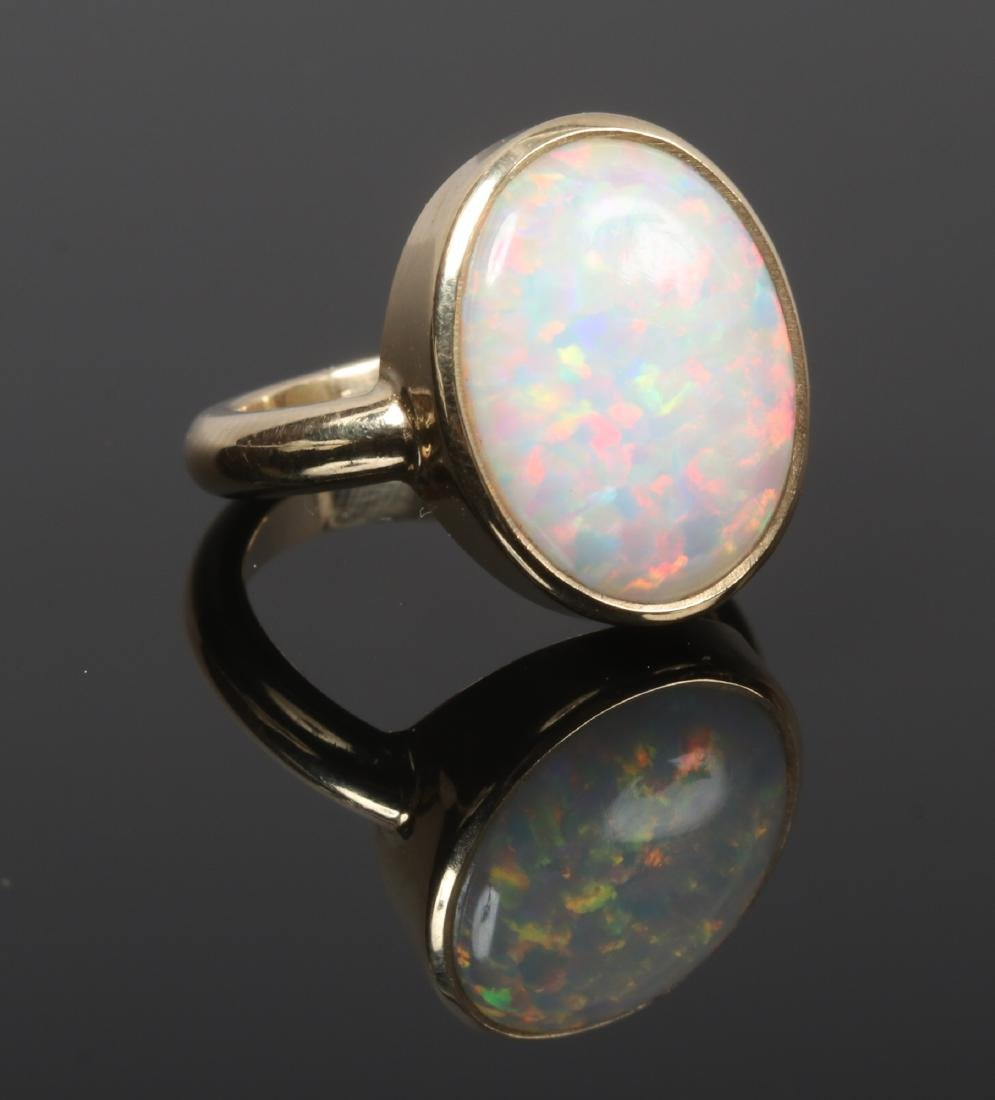 A Gilson opal and yellow metal handmade ring, test as