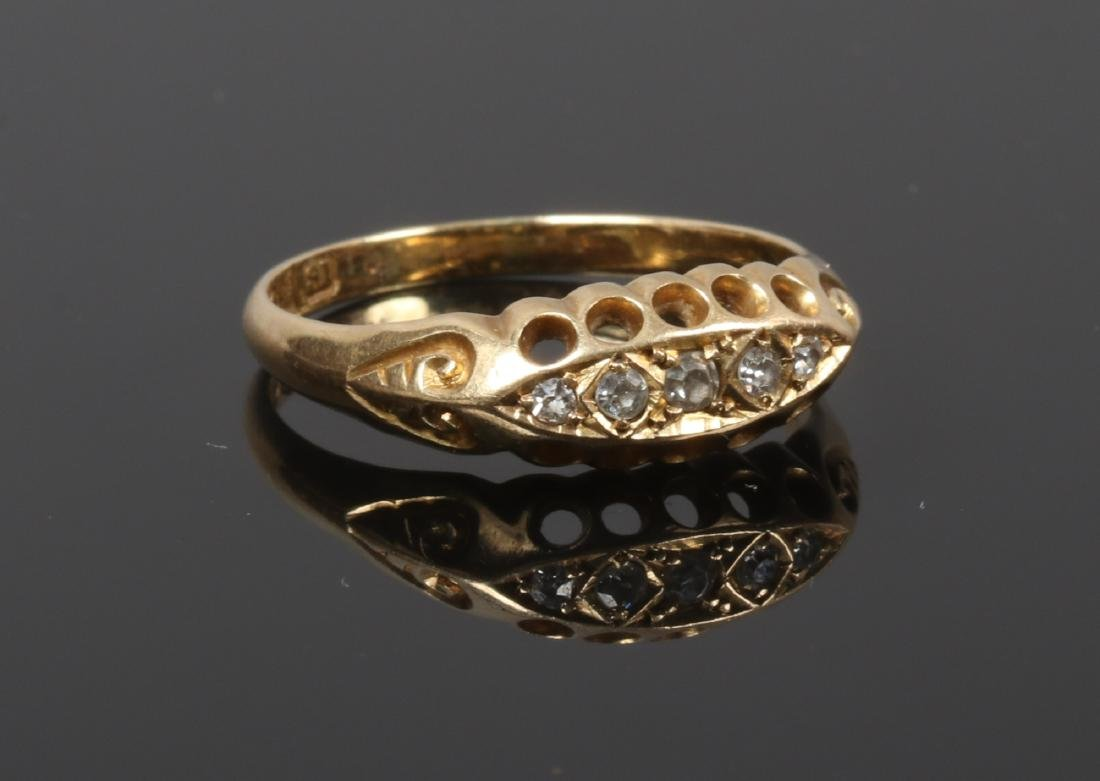 An 18ct gold five stone diamond ring in a boat shaped