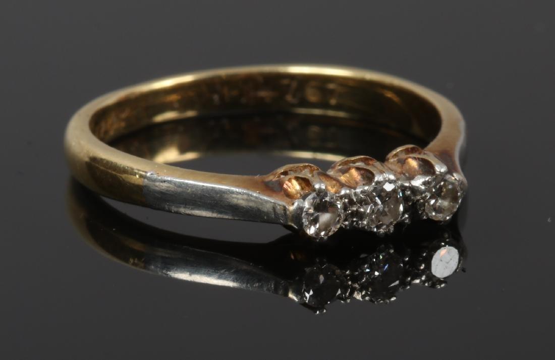 An 18ct gold and five platinum three stone diamond