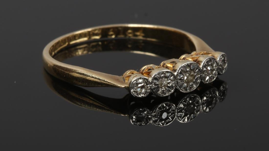 A mid 20th century 18ct gold and platinum five stone