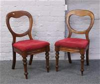 A pair of Victorian mahogany bolt back dining chairs.