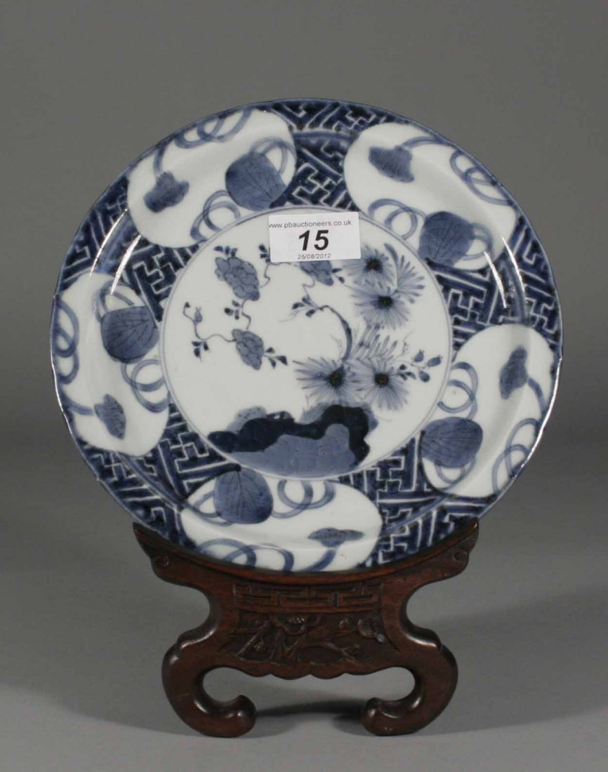 15: A small Japanese arita dish, painted with chrysanth