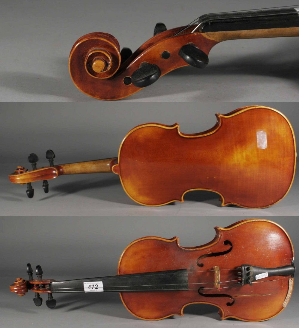 472: A violin in fitted case.