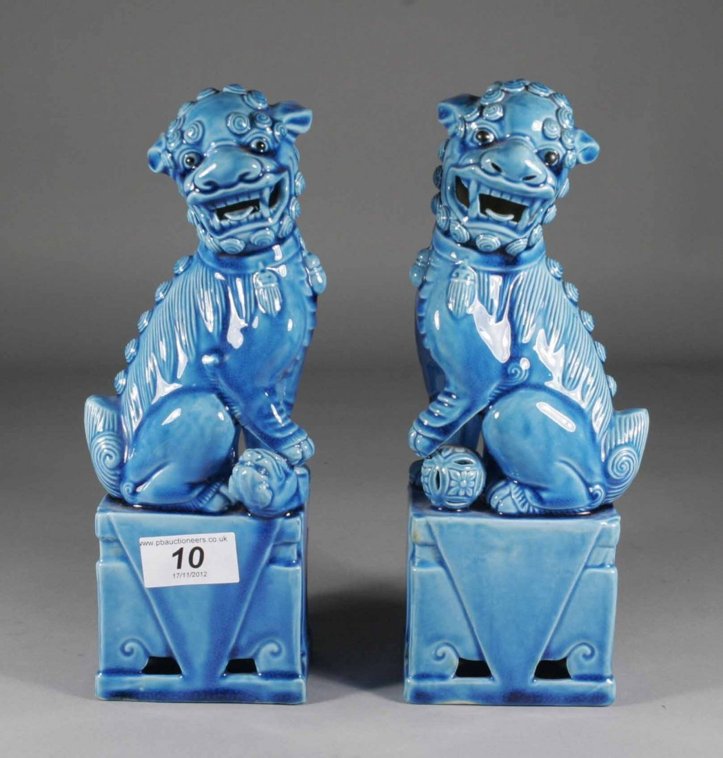 10: A pair of Chinese turquoise glazed models of dogs o