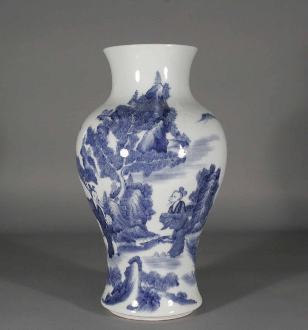 23: A Chinese baluster mantel vase, painted in undergla