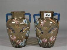 536 A pair of Moser amber glass vases with twin handle