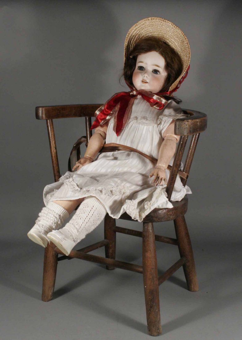 577: An early twentieth century bisque head doll by Sim