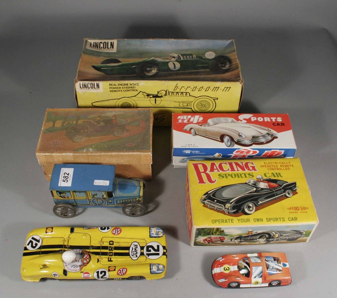 582: Six tinplate toy cars including boxed examples, Cl