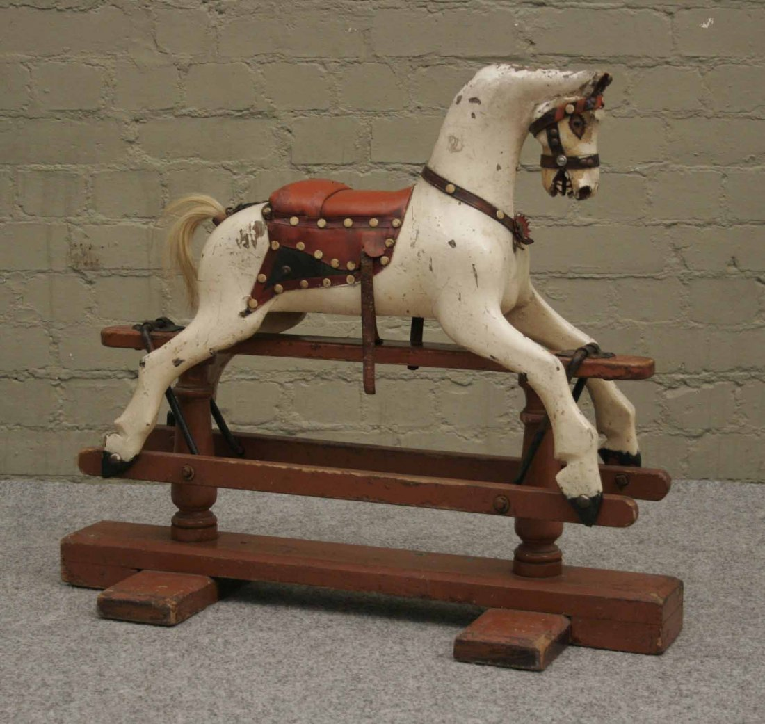 586: A Victorian painted rocking horse of very small pr