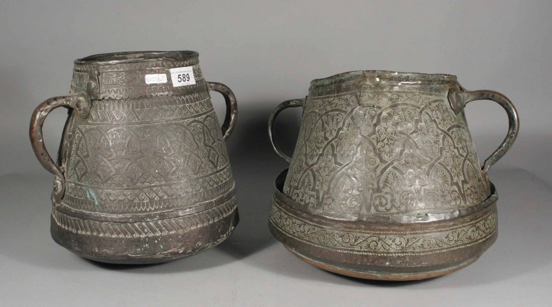589: Two Islamic twin handled copper pots chased with s