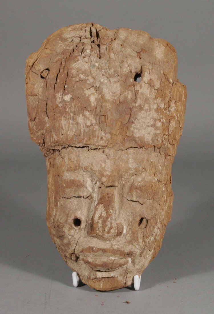 590: A carved softwood and lime washed Egyptian mask la