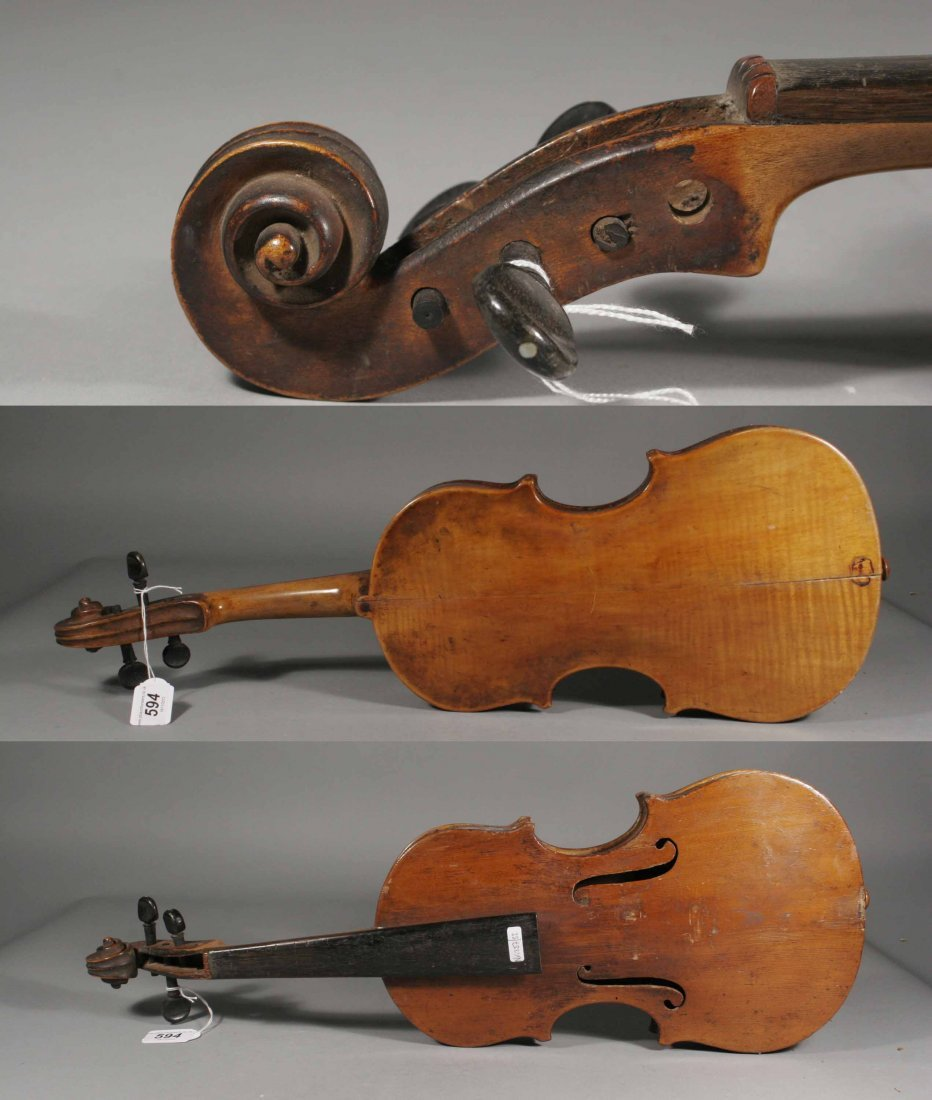 594: A nineteenth century cased violin and bow, 14.25''