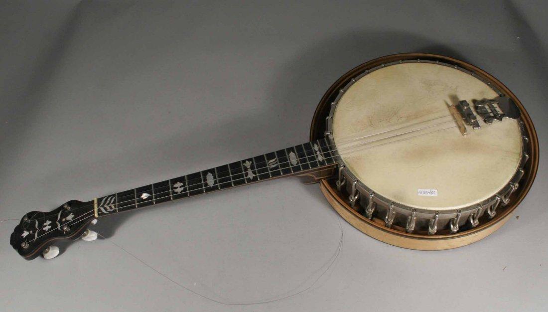596: A four string banjo in case with ebony fretboard a