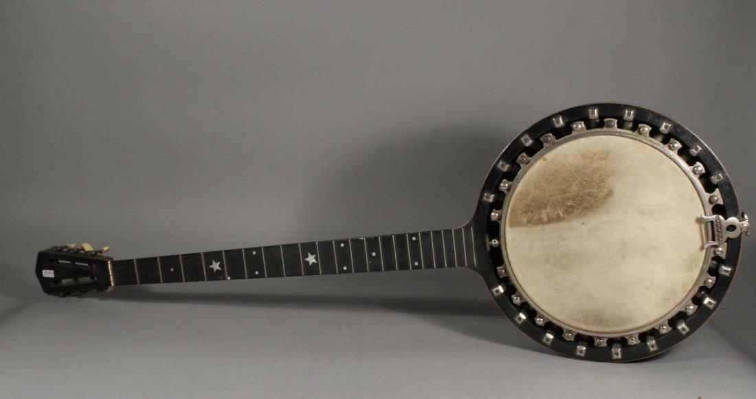 597: A six string banjo in fitted case having ebony fre