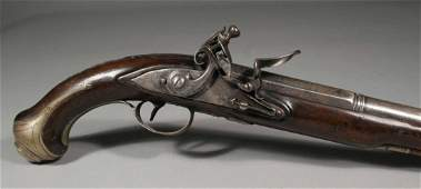 674: A Georgian flintlock pistol with carved walnut ful