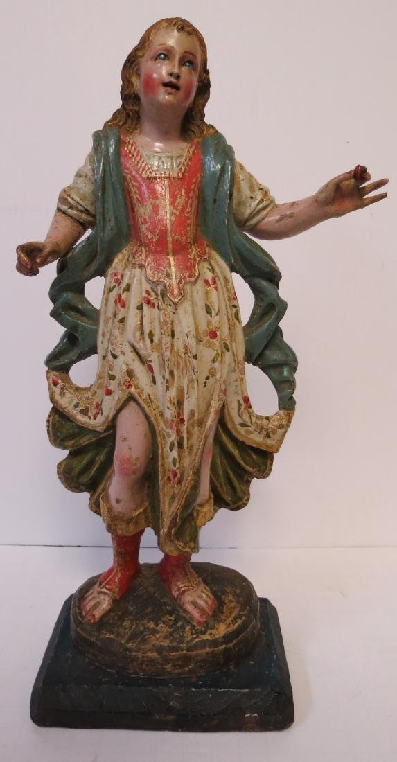 Peruvian wood carving of Saint Raphael