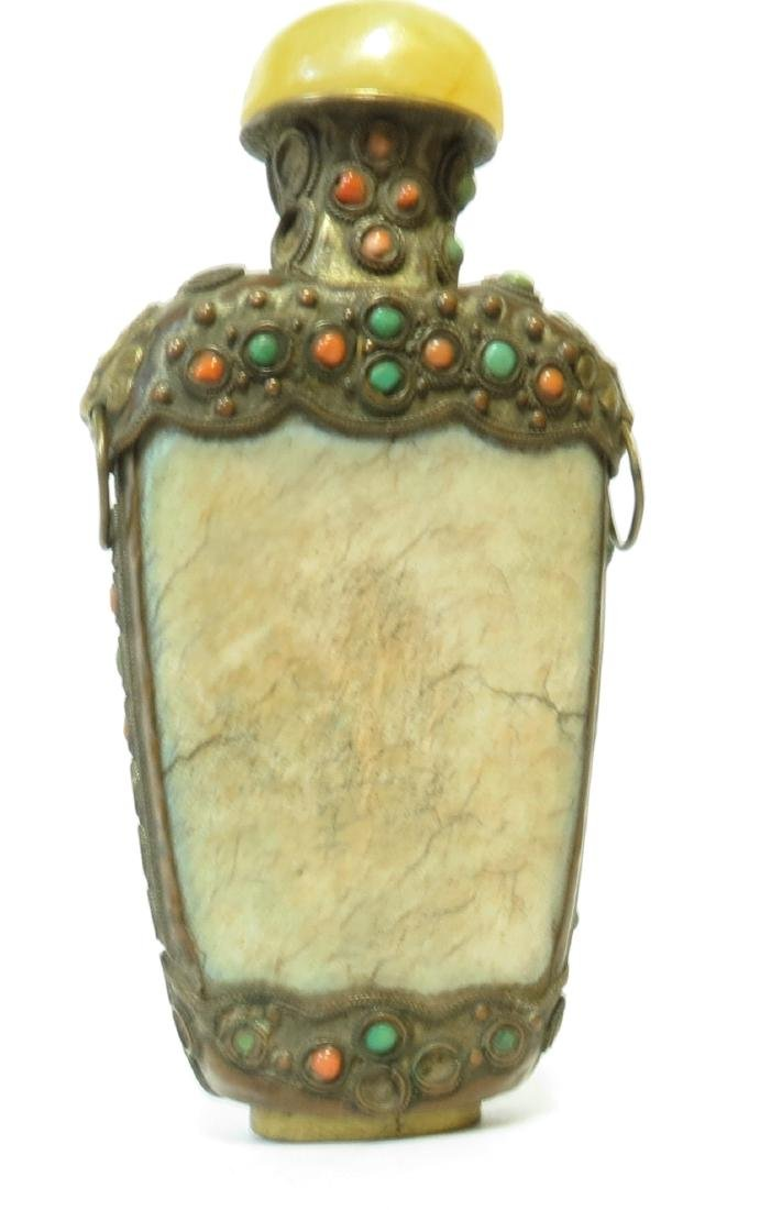 Turquoise with Coral inserts over metal.  Jade Cap