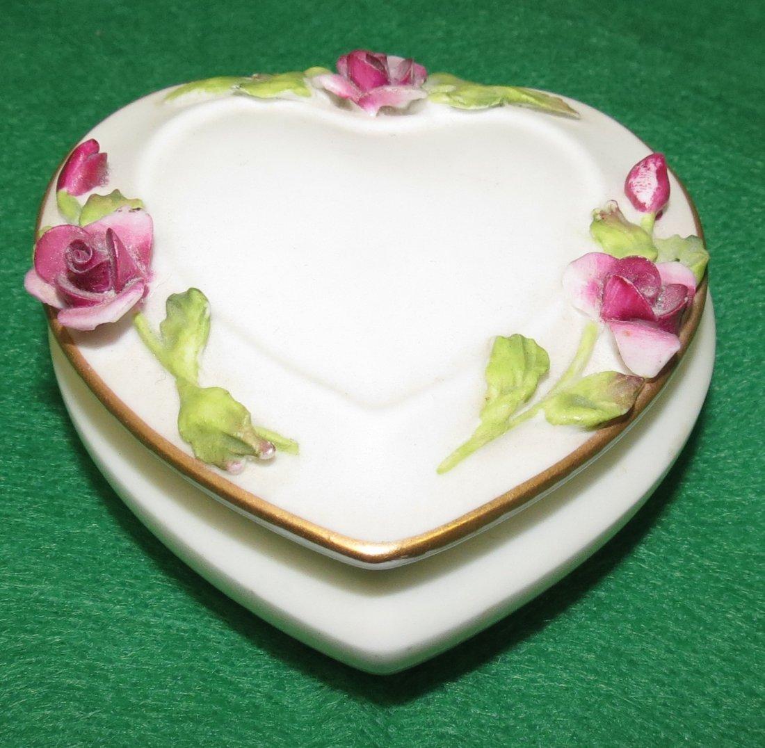 1002: Coalport porcelain Pill Box, England.