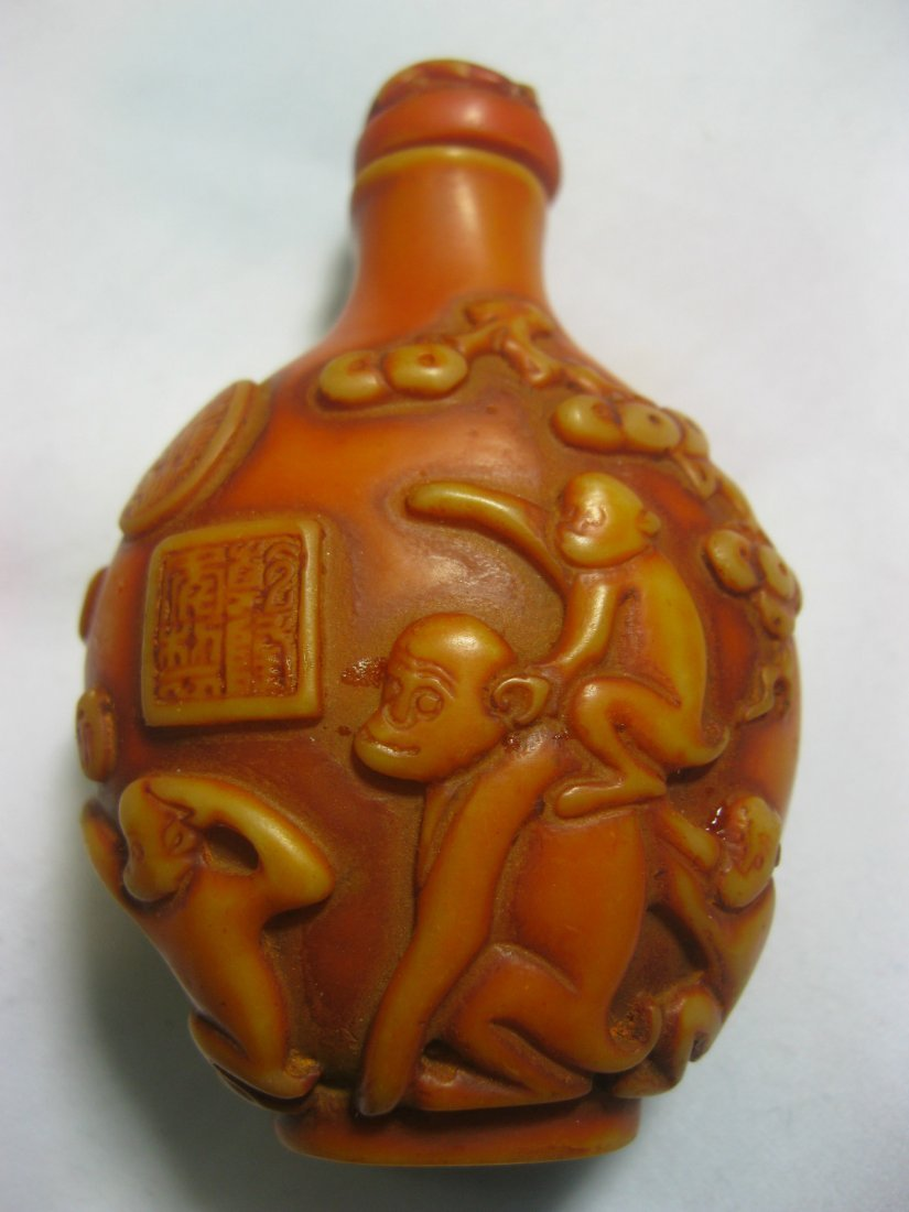 Hand carved bone snuff bottle, monkey figure