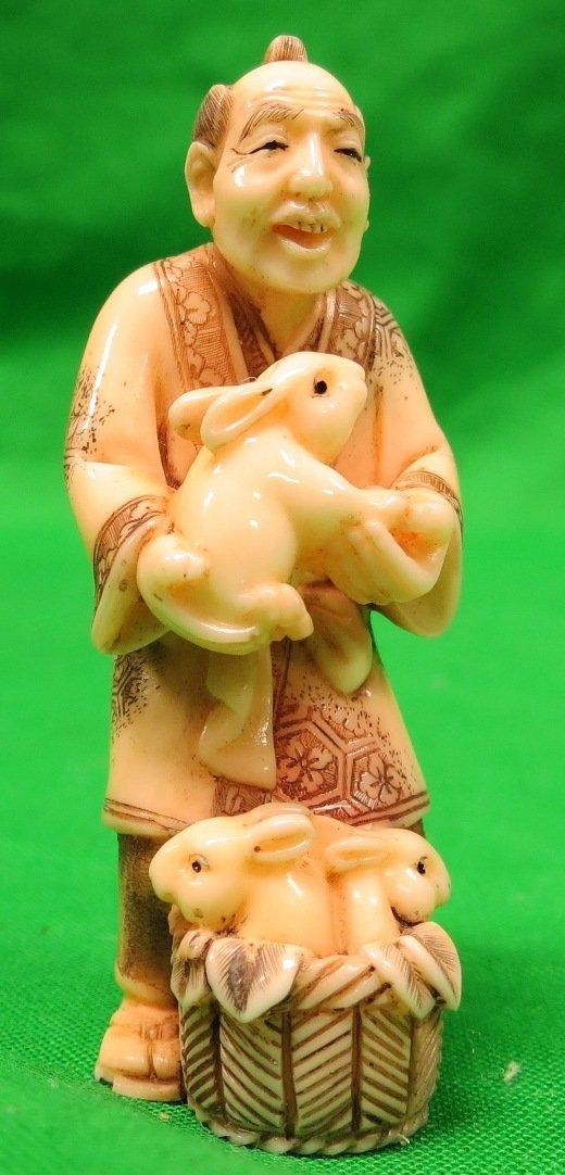 Old Ivory Netsuke Man w/ Rabbits