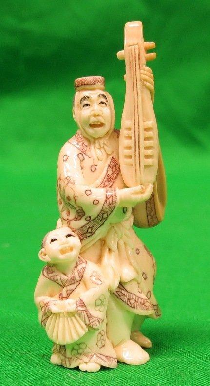 Old Ivory Netsuke Man w/ Girl Musician