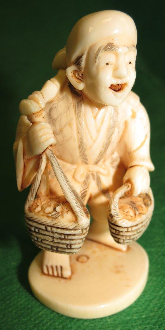 "Ivory Sculpture Farmer at Market Signed. H: 3.1"""