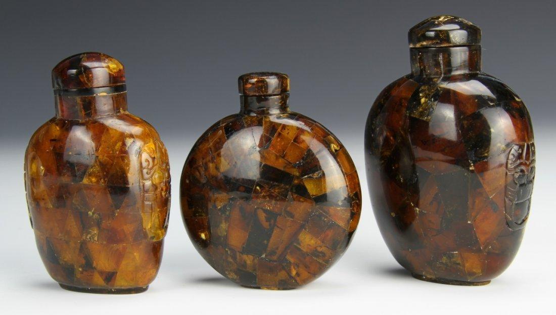 Three Chinese Amber Snuff Bottles
