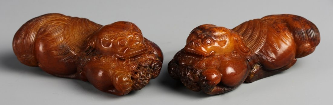 Two Chinese Carved Horn Mythical Creatures