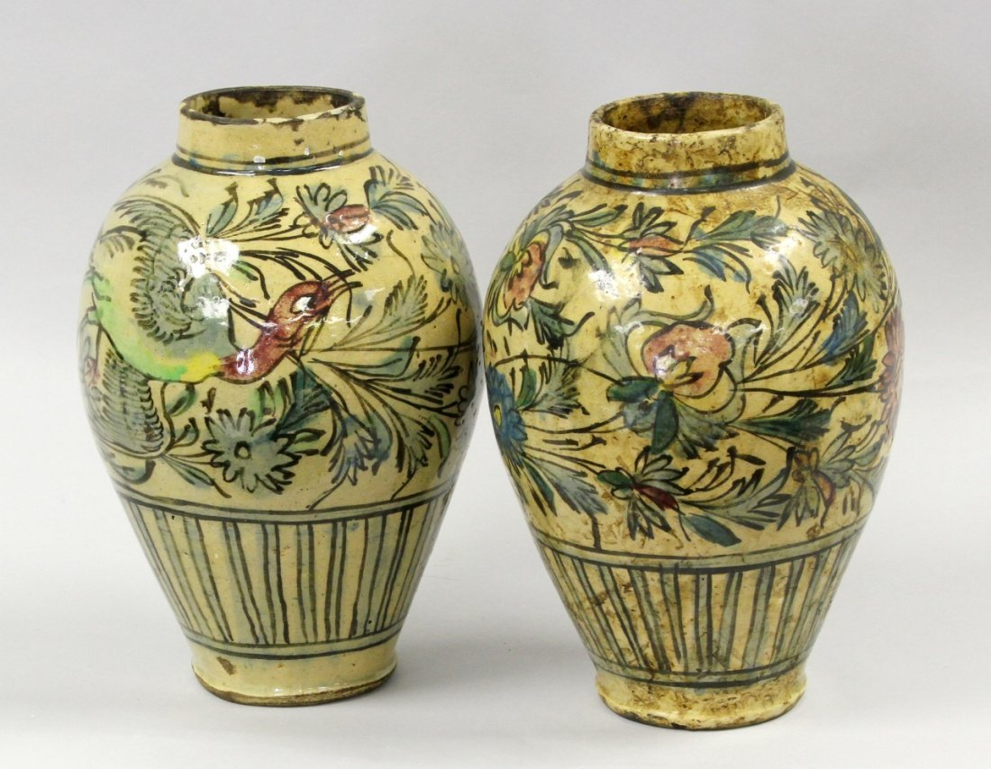Two Persian Pottery Bird and Floral Jars