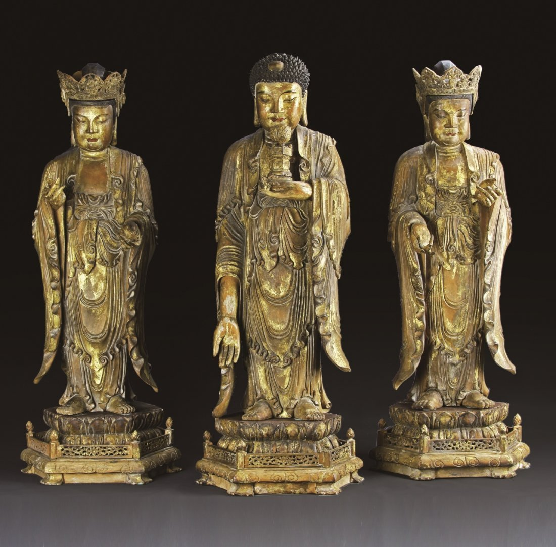 Three Chinese Gilt Carved Standing Buddha Figures