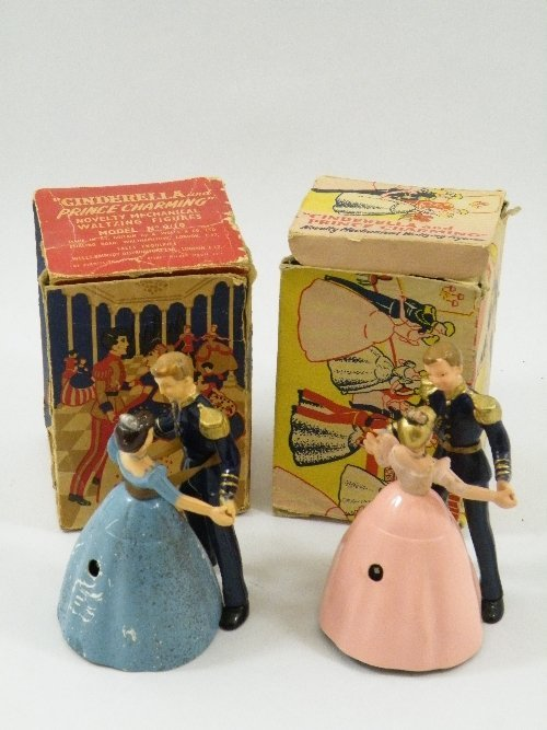 10: Two boxed mechanical novelty toys: Cinderella and P