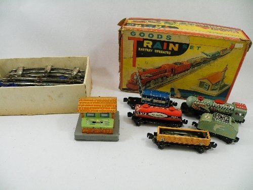 17: A Chinese, tin plate, battery operated Goods Train