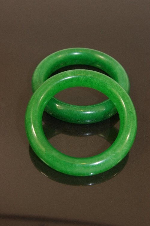 343: Pair of green Chinese jade bangles