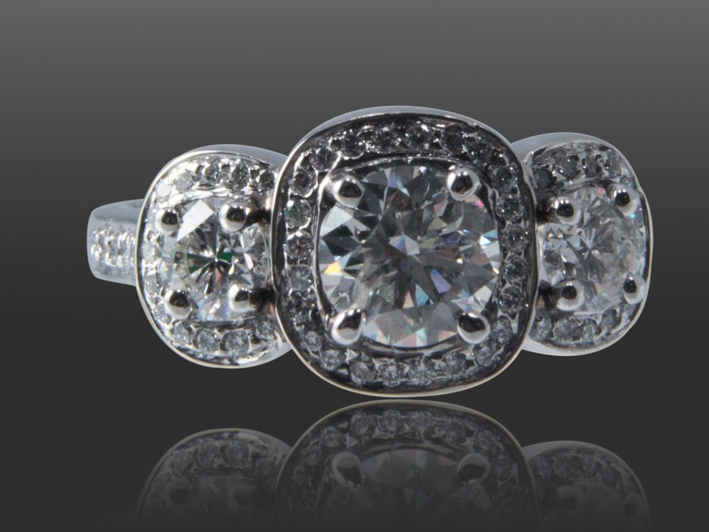 104: 3 STONE RING, WITH CENTER STONE WEIGHING 0.71CT AN