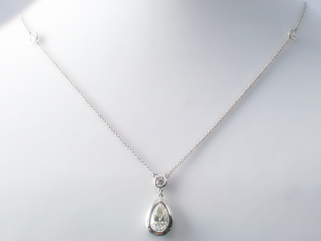 109: 18KT W/G NECKLACE WITH 1.57CT PEAR BRILLIANT DROP