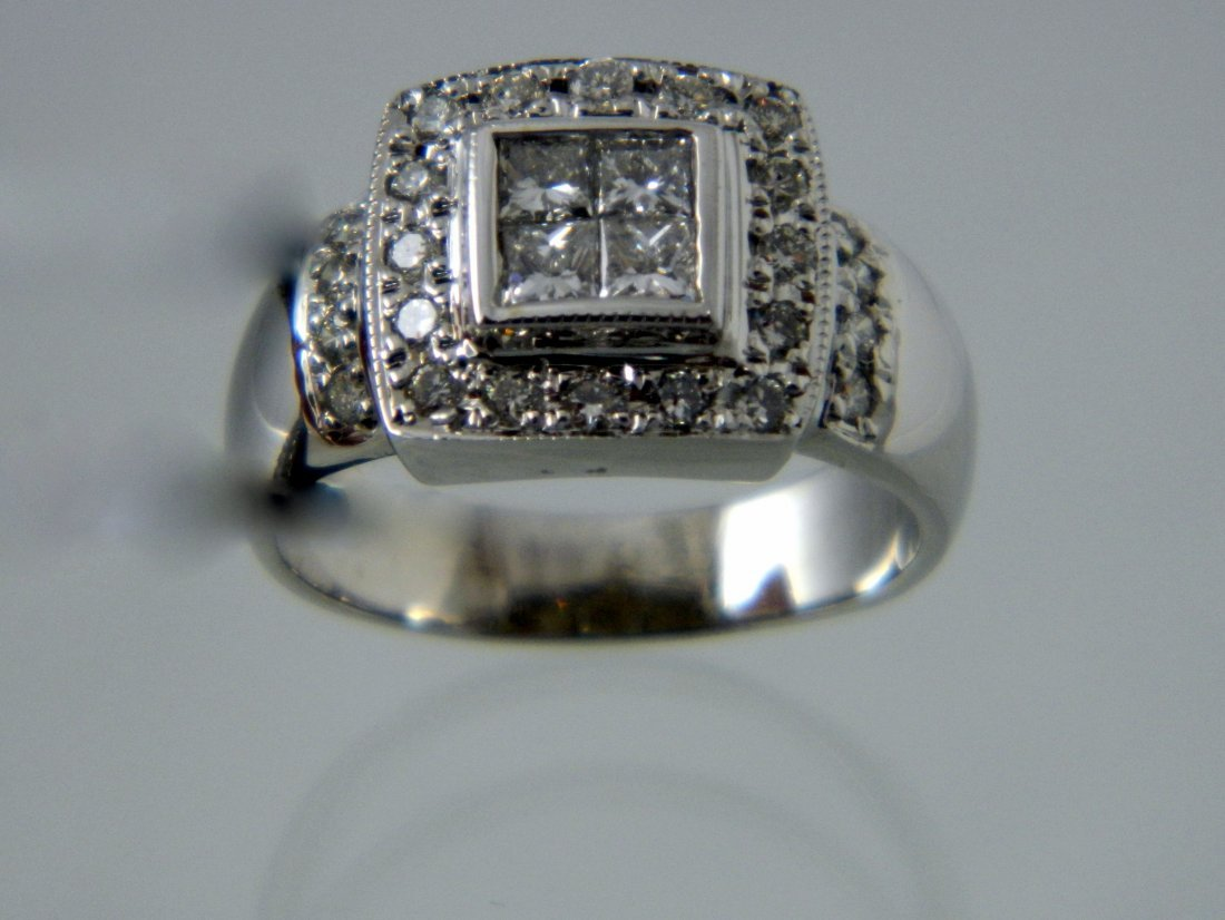 110: 14KT PRINECSS CUT DIAMOND RING .
