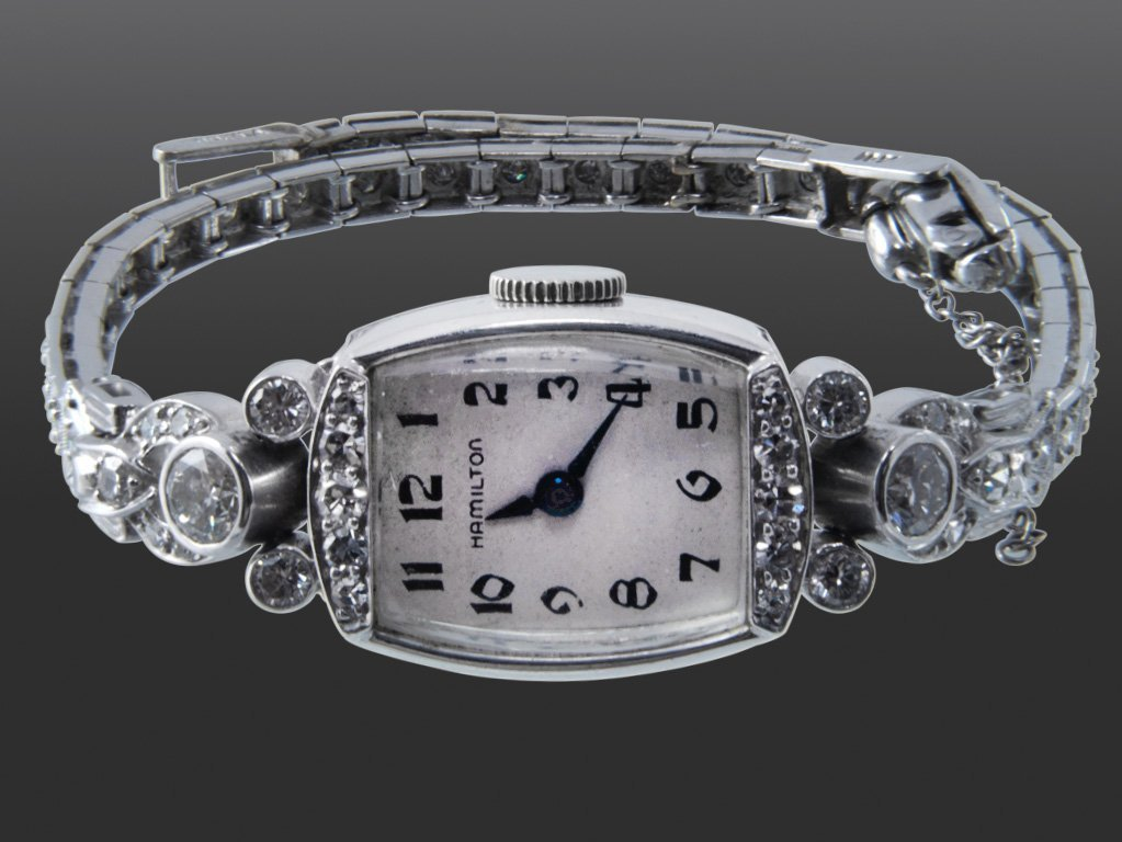114: HAMILTON LADIES PLATINUM AND DIAMOND WRIST WATCH.