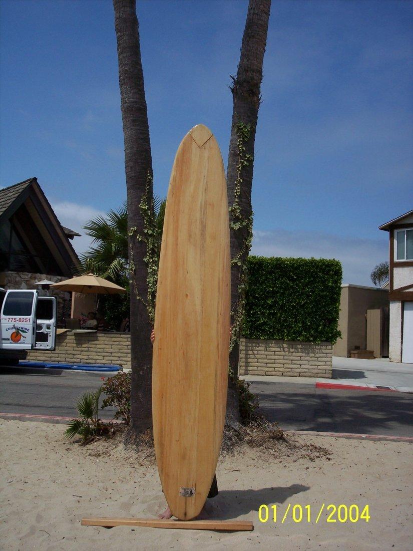 109: 1958 Restored Balsa Surfboard {Bill Holden}