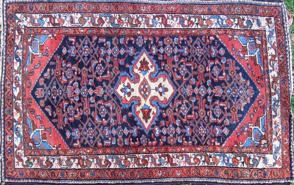 Old Persian blue field scatter rug, 41 by 60 inches.