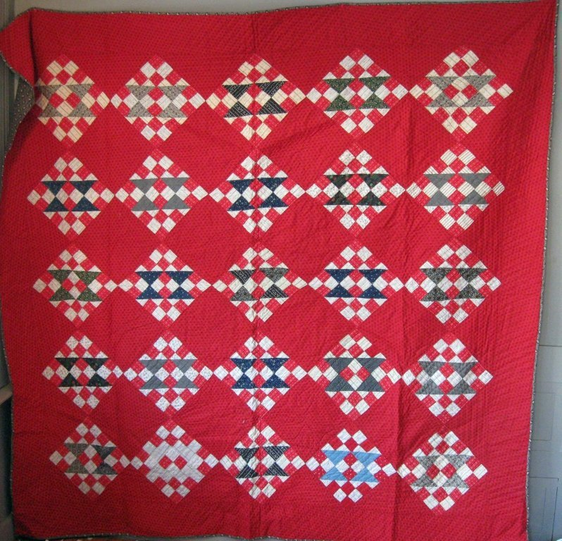 Mennonite patchwork quilt, 74 by 78 inches. Condition: