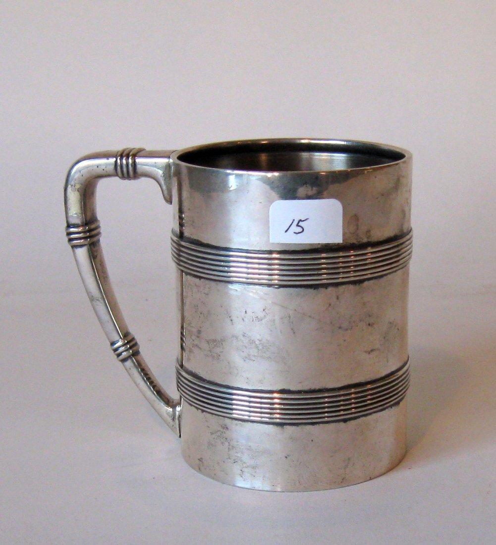 Tiffany & Co Sterling silver mug, 4 inches tall.