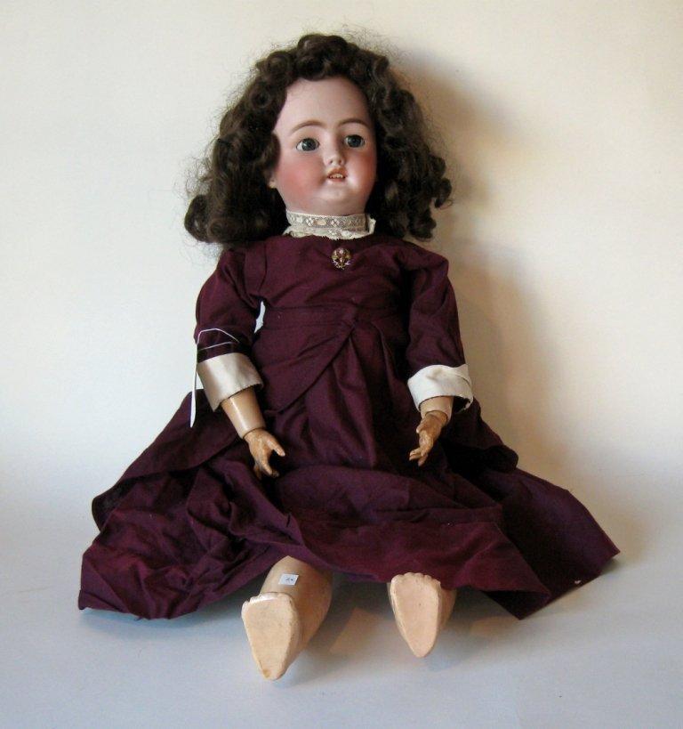 C.M Bergman Simon & Halbig 13.5 bisque-headed doll, 27