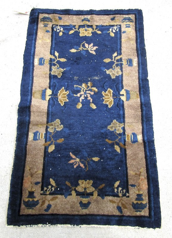 Old Chinese blue filed scatter rug, 45 by 24 inches.